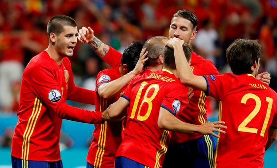 Spain's Alvaro Morata celebrates after scoring their third goal with teammates REUTERS/Yves Herman.