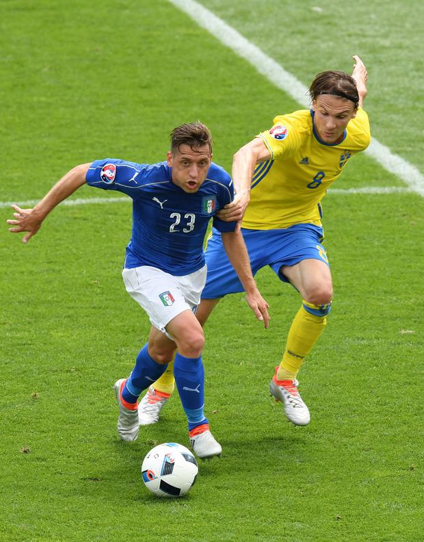 Emanuele Giaccherini is held back by Albin Ekdal (Photo by Dennis Grombkowski/Getty Images)