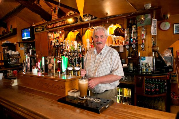 Publican Jack Clancy behind his bar. Picture Credit Brian Gavin