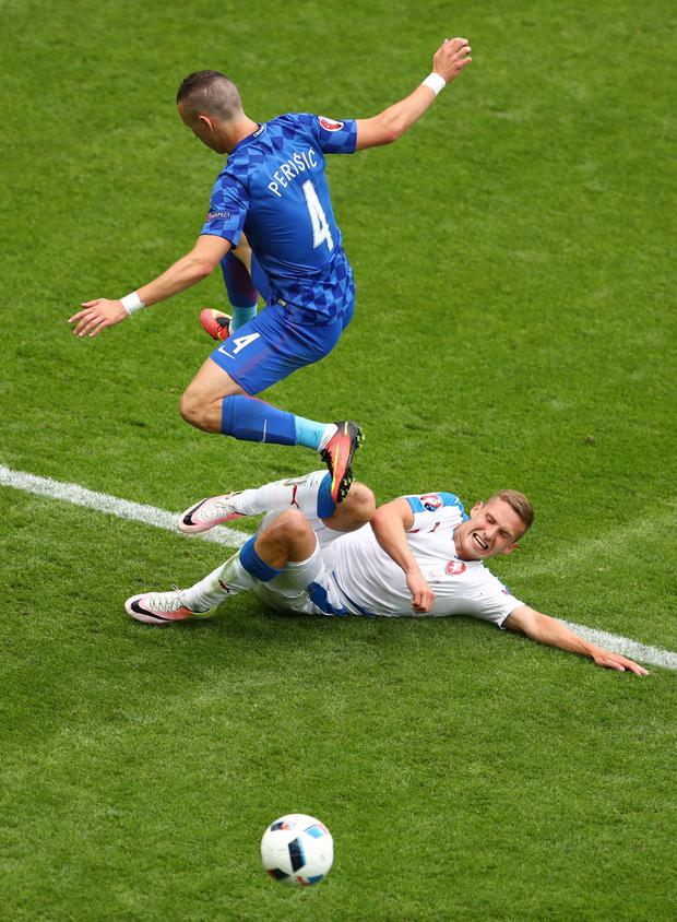 Ivan Perisic jumps over a slide tackle from Jiri Skalak (Photo by Michael Steele/Getty Images)
