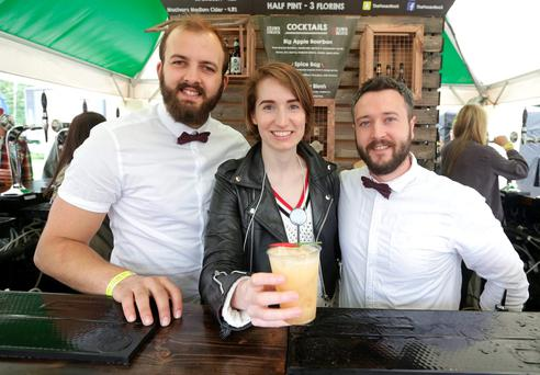 At the Taste of Dublin festival in the Iveagh Gardens were reporter Kirsty Blake Knox tasting a 'Spice Bag' cocktail with bartenders Calum Murray and Steve Cranley. Picture credit; Damien Eagers
