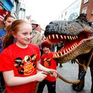 Tiana Mizzoni (11) from Saggart helping guide Rexy to CoderDojo's Coolest Projects. Photo: Conor McCabe