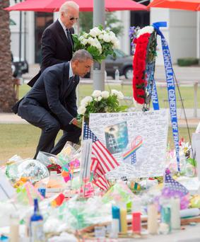 Barack Obama and Joe Biden pay their respects to the victims in Orlando, Florida. Photo: AFP/Getty Images