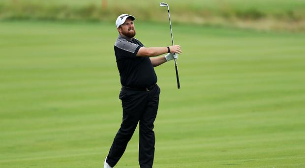 OAKMONT, PA - JUNE 17: Shane Lowry of Ireland hits his second shot on the 18th hole during the continuation of the weather delayed first round of the U.S. Open at Oakmont Country Club on June 17, 2016 in Oakmont, Pennsylvania. (Photo by David Cannon/Getty Images)