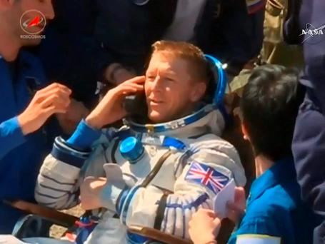 Screen grabbed image taken from NASA TV of British astronaut Tim Peake after arriving back on earth from the International Space Station