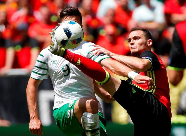 Belgium's Thomas Vermaelen in action with Republic of Ireland's Shane Long