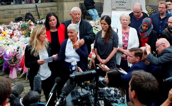 Kim Leadbeater (L), the sister of murdered Labour Party MP Jo Cox, speaks as her parents Gordon and Jean Leadbeater (C) listen in Birstall, Britain June 18, 2016. Danny Lawson/Press Association via REUTERS