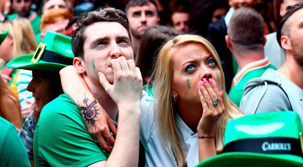 Republic of Ireland fans react in The Living Room bar in Dublin City Centre after Belgium score their third goal during the Euro 2016 match between Republic of Ireland and Belgium