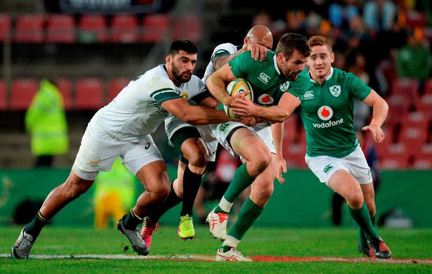 Jared Payne of Ireland is tackled by Damian de Allende, left, and Lionel Mapoe of South Africa during the Castle Lager Incoming Series 2nd Test game between South Africa and Ireland at the Emirates Airline Park in Johannesburg, South Africa. Photo by Brendan Moran/Sportsfile