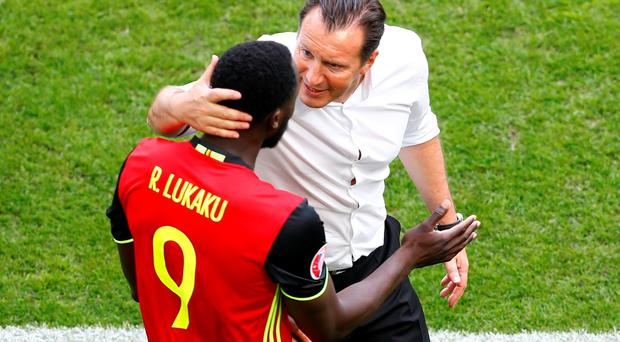 Belgium's Romelu Lukaku celebrates scoring their first goal with Belgium head coach Marc Wilmots