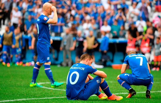 Iceland's players react at the end of the Euro 2016 group F football match between Iceland and Hungary at the Stade Velodrome in Marseille on June 18, 2016. / AFP PHOTO / BORIS HORVATBORIS HORVAT/AFP/Getty Images