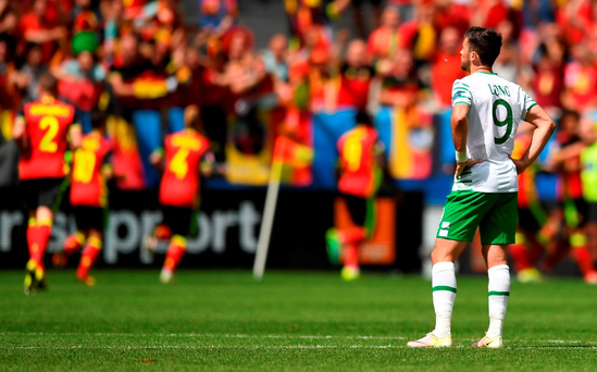 Ireland's Shane Long watches as Belgium celebrate their third goal during their Euro 2016 Group E match in Bordeaux. Photo: Stephen McCarthy/Sportsfile