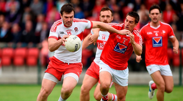 18 June 2016; Mark Bradley of Derry in action against Padraig Rath of Louth during the GAA Football All-Ireland Senior Championship Qualifier Round 1A match between Derry and Louth at Owenbeg Centre of Excellence in Dungiven, Derry. Photo by Oliver McVeigh/Sportsfile