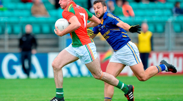18 June 2016; Hughie Gahan of Carlow in action against Stephen Kelly of Wicklow in the GAA Football All-Ireland Senior Championship Qualifier Round 1A match between Carlow and Wicklow at Netwatch Cullen Park in Carlow. Photo by Ray Lohan/Sportsfile