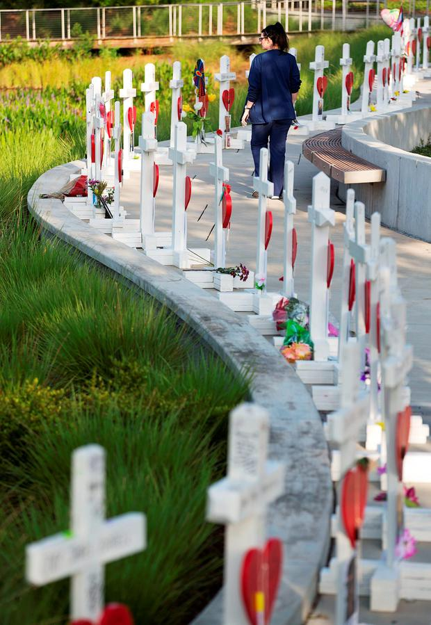 In memory: Crosses, one for each victim, line a walkway as a memorial to those killed in the Pulse nightclub shootings a few blocks from the club in Orlando. Photo: David Goldman/PA