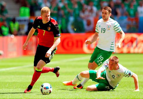 Belgium's Kevin De Bruyne gets away from Ireland's James McCarthy during the Euro 2016 match in Bordeaux. Photo: Martin Rickett/PA
