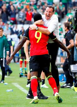 Belgium coach Marc Wilmots celebrates with Romelu Lukaku after the player scored his team's first goal in the match against the Republic. Photo: Michael Dalder/Reuters