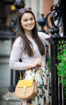 Taking a 'glamble': Rosee Byrne, a beauty blogger from Clontarf, with a Chloé Drew Bag, with a retail price of €1,390, purchased online from designerbid.com for €20.56, plus €60 in bids. Photo: Colin O'Riordan