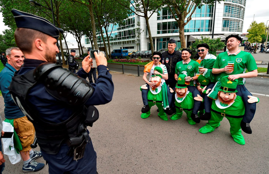 Republic of Ireland supporters get a warm welcome from police ahead of a Euro 2016 Group E match in France. Photo: Paul Mohan/Sportsfile