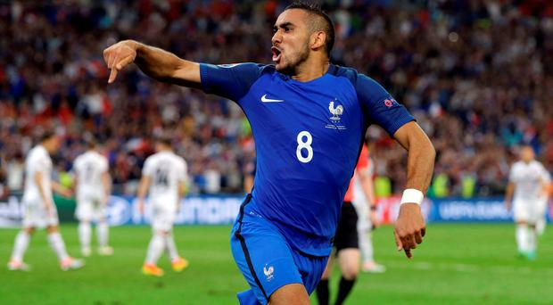Dimitri Payet celebrates after scoring against Albania: 'Our kids are much more likely to put out bunting for the Queen's birthday than if France win the Euros,' says Dani Allen, wife of Laurent Benezech. Photo: Thanassis Stavrakis/AP