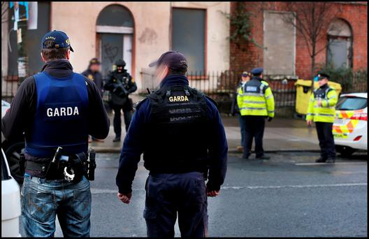 Gangland feud: Armed gardai on duty at Ballybough Bridge after Eddie Hutch's body was brought home to Portland Row in February during tit-for-tat killings by rival Dublin gangs