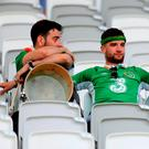 Republic of Ireland fans appear dejected after the match. Photo: PA