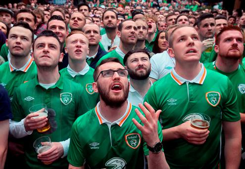 Fans held spellbound in the Living Room bar in Dublin city centre. Photo: PA