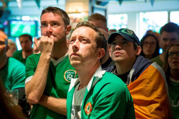 Defeat is etched on the faces of fans Colm Nolan, Darragh O'Connor and Mick Fennell at the Goat pub, Goatstown