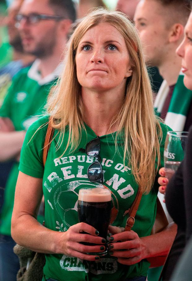 Disbelief: Scores of fans who had gathered in Dublin's Copper Face Jacks were left slack-jawed in disbelief as Ireland's Euro odyssey now hangs by a thread after a 3-0 defeat to Belgium. In the end, Martin O'Neill's charges were simply outplayed by a superstar squad. Now we can only hope for a minor miracle against the Italians — and a much-needed smile from the gods. Pictured is one of the fans in Harcourt Street watching the game yesterday. Photo: Fergal Phillips