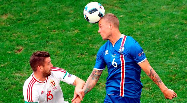 Hungary's Daniel Bode, left, and Iceland's Ragnar Sigurdsson, right, challenge for the ball during the Euro 2016 Group F match in Marseille. Photo: Claude Paris/AP
