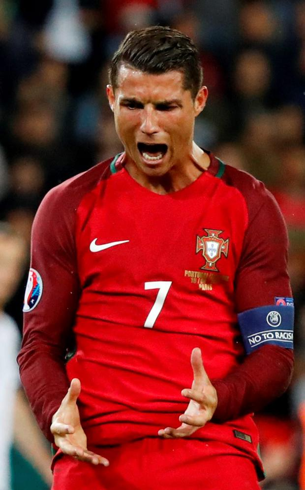 Portugal's Cristiano Ronaldo reacts after missing a penalty in the Group F game against Austria. Photo: Christian Hartmann/Reuters