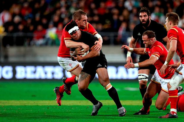 Malakai Fekitoa of the All Blacks is stopped in his tracks by the Welsh defence. Photo by Martin Hunter/Getty Images