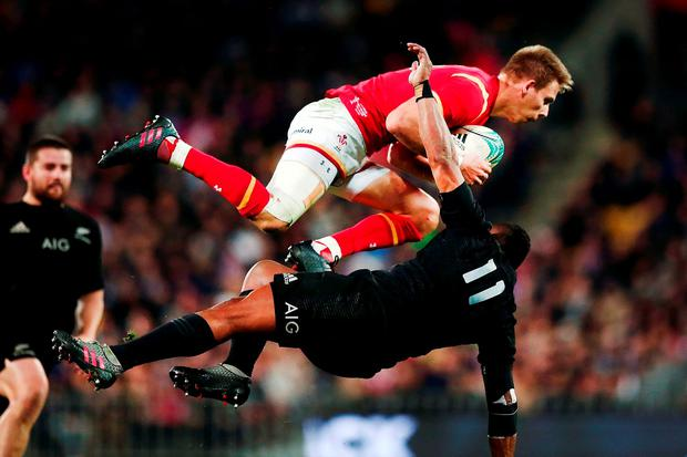 iam Williams of Wales clashes with Waisake Naholo of New Zealand. Photo by Anthony Au-Yeung/Getty Images