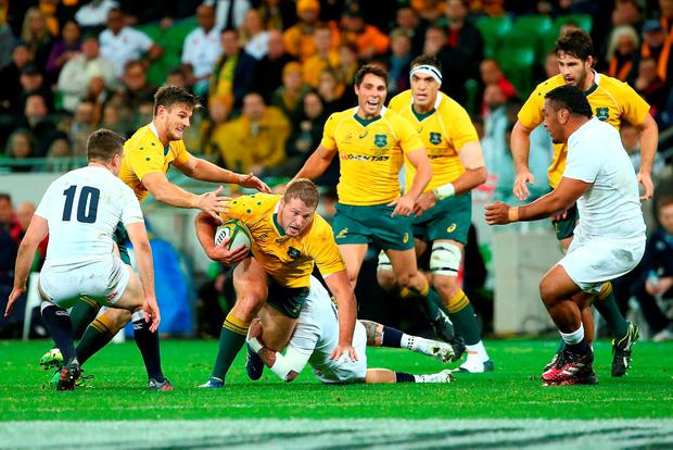 James Slipper of the Wallabies runs with the ball. Photo by Scott Barbour/Getty Images