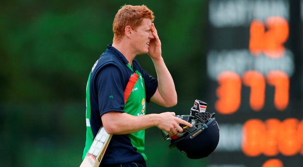 Ireland's Kevin O'Brien leaves the field after being caught by Farees Maharoof from a delivery by Dasun Shanaka at Malahide. Photo: Seb Daly/Sportsfile