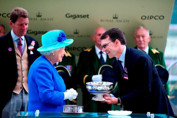 Queen Elizabeth II presents the Leading Trainers Trophy to Aidan O'Brien on day 5 of Royal Ascot. Photo: Charlie Crowhurst/Getty