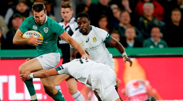 Ireland's Jared Payne (left) is tackled by South Africa's Willie le Roux. Photo: Siphiwe Sibeko/Reuters