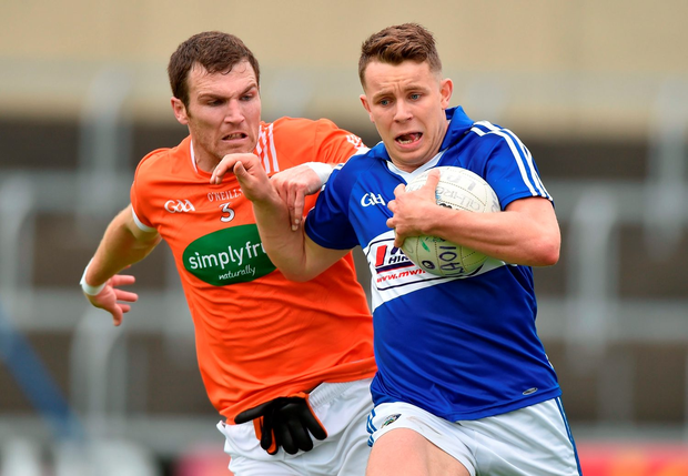 18 June 2016; Stephen Attride of Laois in action against Brendan Donaghy of Armagh during the GAA Football All-Ireland Senior Championship Qualifier Round 1A match between Laois and Armagh at O'Moore Park in Portlaoise, Co. Laois. Photo by Matt Browne/Sportsfile
