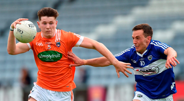 Joe McElroy of Armagh in action against Niall Donoher of Laois. Photo by Matt Browne/Sportsfile
