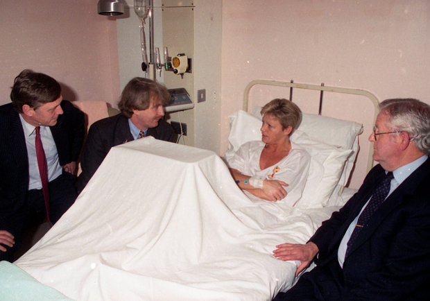 Veronica Guerin in her hospital bed after being treated for gunshot wounds to her leg. She is pictured with senior executives of Independent Newspapers, David Palmer, Aengus Fanning editor of the Sunday Independent and Liam Healy, CEO. Picture: Matt Walsh/INM