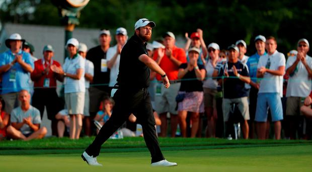 Shane Lowry of Ireland reacts on the ninth hole during the third round of the U.S. Open at Oakmont