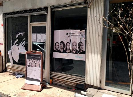 A ripped up poster advertising the streaming event of Radiohead's new album, at a record shop, in Istanbul, Saturday (AP Photo/Dominique Soguel)