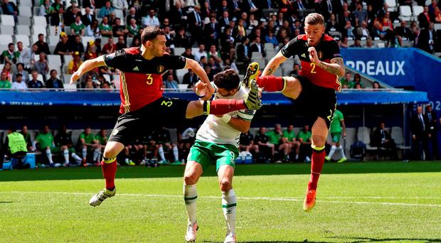 18 June 2016; Shane Long of Republic of Ireland in action against Thomas Vermaelen and Toby Alderweireld of Belgium during the UEFA Euro 2016 Group E match between Belgium and Republic of Ireland at Nouveau Stade de Bordeaux in Bordeaux, France. Photo by David Maher / Sportsfile.