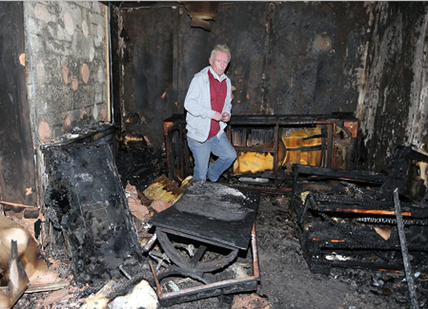 Pat Murphy pictured in his burnt out Clondalkin home. (Photo: Sunday World)
