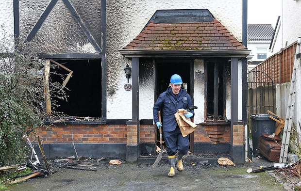 Gardai at 30 Monksfield Grove, Clondalkin, Dublin on February 24, 2014, after an alleged petrol bomb was thrown through the front window of the house, starting a fire which gutted the house. Picture: Colin Keegan