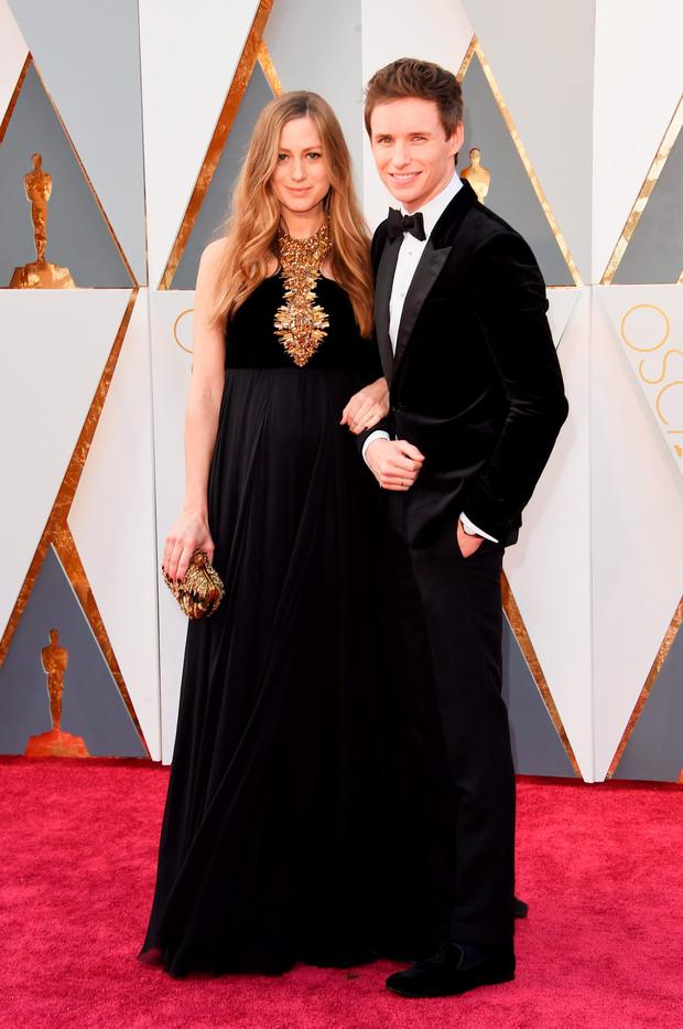 Actor Eddie Redmayne (R) and Hannah Redmayne attend the 88th Annual Academy Awards