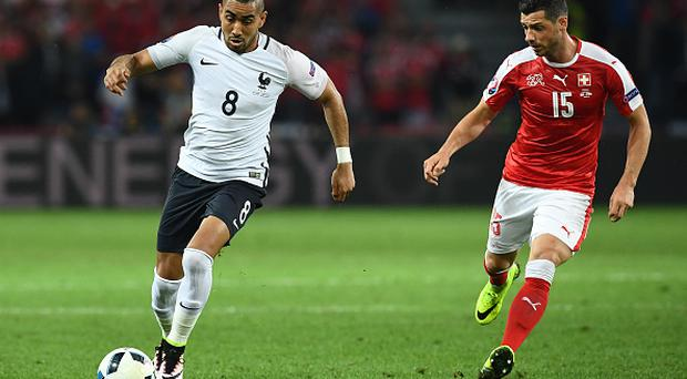 France's forward Dimitri Payet (L) vies for the ball against Switzerland's midfielder Blerim Dzemaili during the Euro 2016 group A football match between Switzerland and France at the Pierre-Mauroy stadium in Lille on June 19, 2016. / AFP / FRANCK FIFE (Photo credit should read FRANCK FIFE/AFP/Getty Images)