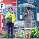 People are caught in a heavy downpour in Westport, Co Mayo yesterday Photo: Paul Meale