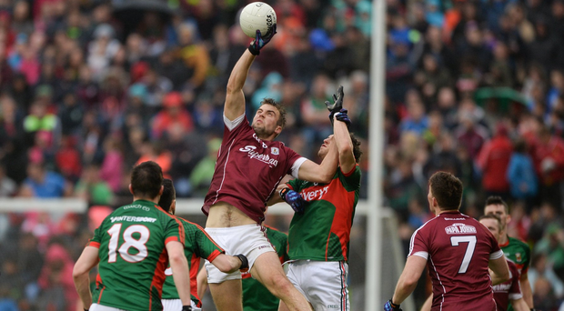 Paul Conroy in action against Tom Parsons Photo by Daire Brennan/Sportsfile