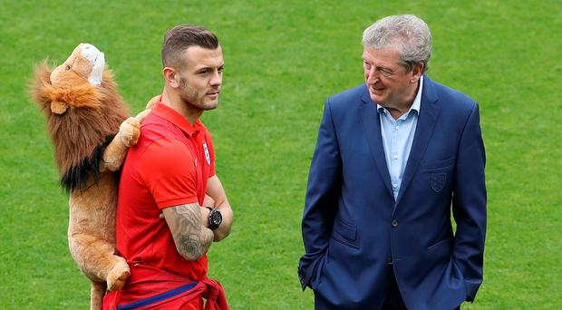 Jack Wilshere, carrying the England team's lion mascot, in conversation with manager Roy Hodgson on the pitch in Saint Etienne. Photo: Owen Humphreys/PA Wire